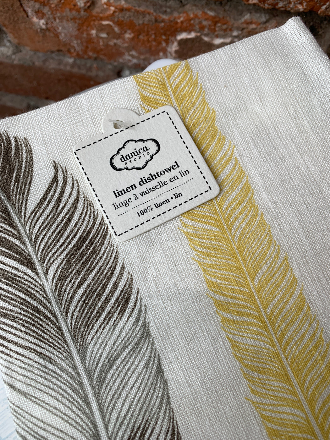 Danica Studios 100% linen dishtowel with feather print. Sold individually.