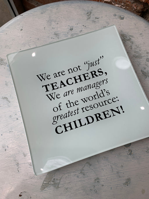 "Tell a teacher how much you appreciate their dedication and hard work with this decorative plate that celebrates one of our noblest professions. The thoughtful quote embellishing this 6-inch-square plate reminds them of their meaningful impact. Perfect for holding jewelry, coins or other small trinkets or to display on a desk. Makes a great end-of-the-year gift for your child's teacher or treat a teacher-friend with this tribute. On plate: We are not ""just"" teachers, we are managers of the world's greatest"