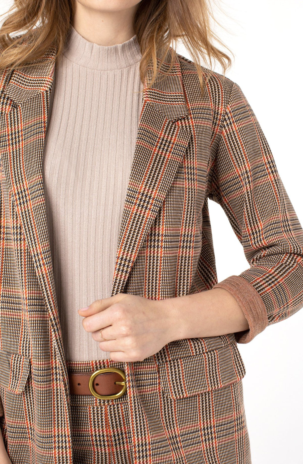"Plaid perfection with a vintage feel!  This plaid boyfriend blazer is sophisticated and versatile from day or night! We are loving the neutral tones with a hint of color.   FEATURES:   28-1/2"" HPS Princess dart styling Two front flap pockets Sleek modern style and a relaxed fit"