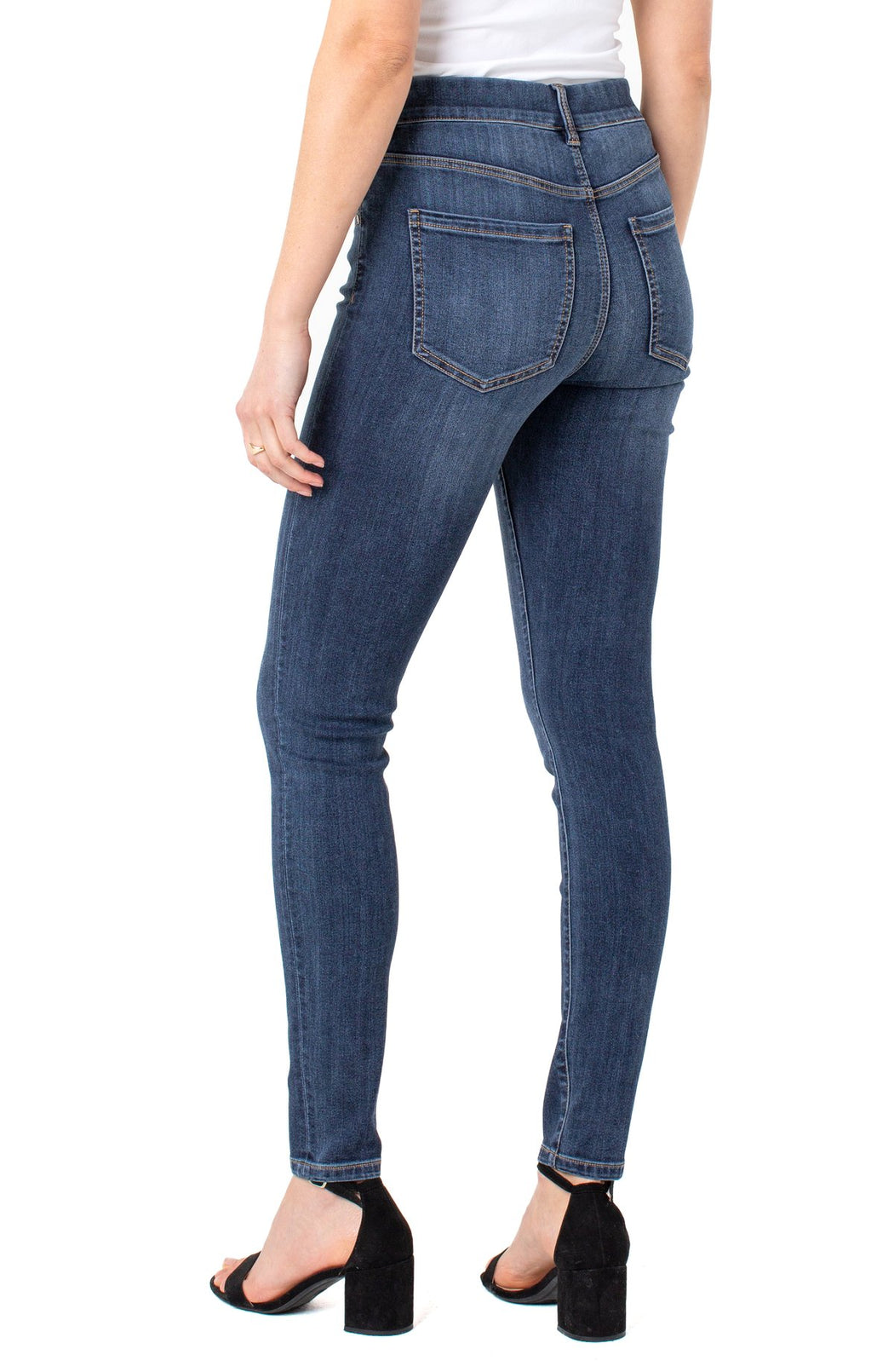 "Glide-on and GO! It's that easy. The Gia is the perfect hybrid between a pull-on and a 5-pocket jean! Our Silky Soft Basel Wash is versatile and comfortable!   FEATURES:  30"" inseam Mid-rise Encased elastic waistband with belt loops 10"" Front rise; 9-3/4"" Leg opening for size 4 Faux zipper with single button detail Working pockets Amazing stretch and excellent recovery (Does not bag out)"