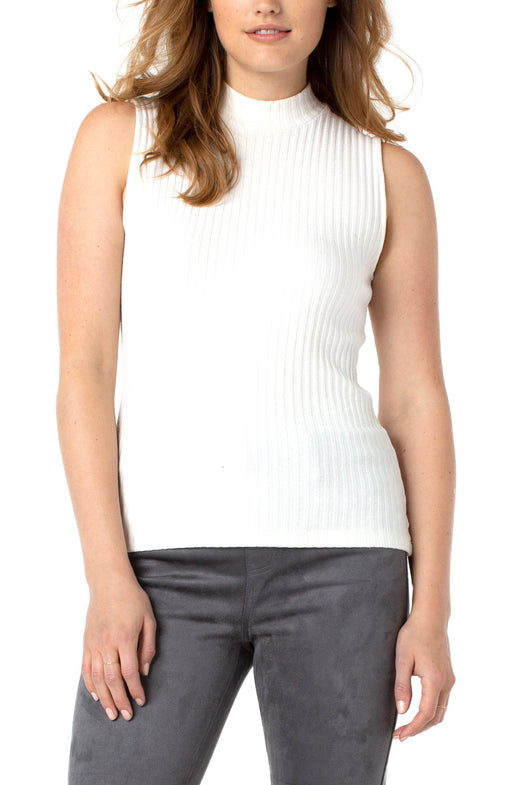 Our mock neck sleeveless rib-knit top is the perfect style this season. Pair with your favorite denim or trouser for a versatile look. Layers well under denim jackets or blazers! Fit to perfection and super comfortable!   FEATURES:  Large rib knit Beautiful neutral colors Mock neck Sleeveless