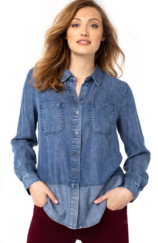 Our updated chambray shirt comes with a beautiful chambray contrast block detail. This indigo slub button-up is the perfect day to night shirt for those looking for versatility and ease. Complete a Canadian tuxedo look with your favorite pair of jeans.   FEATURES:  27'' HPS Double front patch pockets Rolled sleeve tab Button front closure