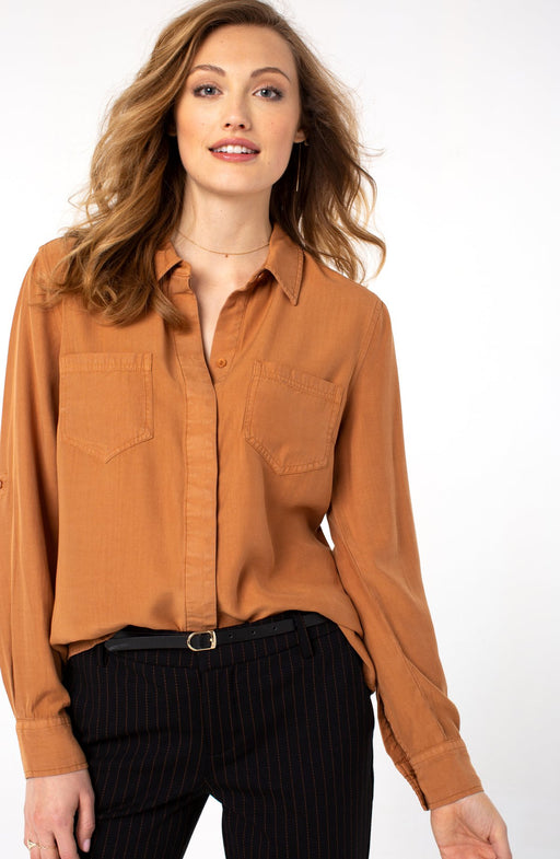 "Our hidden placket shirt in a fabulous deep honey color is easy to wear. Features an overlapping shirt tail vent for added character.  FEATURES: 27-1/2"" HPS Hi-low hem detail Hidden placket button front closure Rolled sleeves with button tab closure"