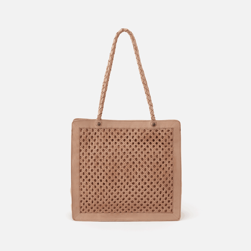 Meet Inspire. The perfect summer tote made to take you places. Crafted in our new lattice weave, a limited-edition handcrafted woven leather that celebrates the timeless romance of rattan craft. Hand-dyed and washed after sewing, care should be taken with light colored fabrics to avoid color transfer. A leather protector applied before use may help to seal the color.