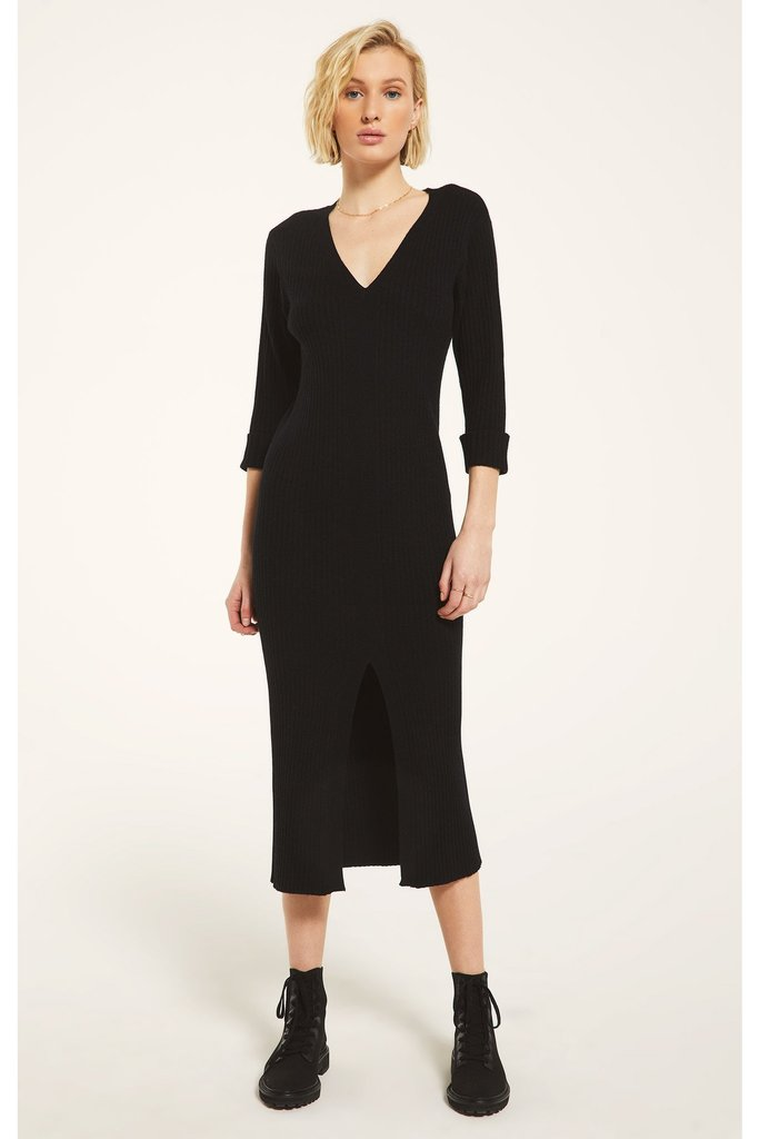 With its vintage feel and slimmer silhouette, the Moser Dress is your easy answer to any outfit question. This v-neck dress has slim fit sleeves that have been tucked, and a ribbed neckband that leads down all the way down the stitched closure. A slit is left open at the bottom for just a hint of skin or to show off your fave boots!