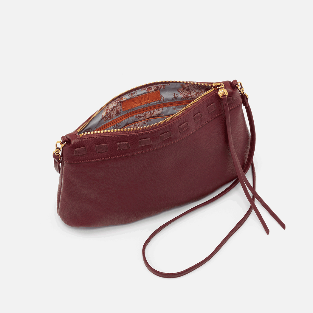 With our new convertible crossbody, Birch, you can wear it your way from day to day. Adjust the strap to wear it as a short shoulder bag or remove it to carry as an oversized clutch. Structured in shape and wonderfully soft, Birch will soon be that crossbody you always reach for. Crafted in our signature velvet hide, our softest and most casual leather that only gets more beautiful over time.