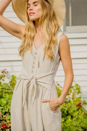 ESSENTIAL JUMPSUIT FEATURED IN LINEN FABRIC WITH BUTTON-UP DETAIL AND V-NECKLINE, WAIST TIE   -55% LINEN 45% COTTON