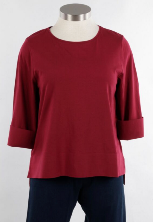 A hard working basic, the all cotton Deep Hem Tee features a wide round neckline, three quarter length sleeves with sturdy cuffs for folding back, and an uneven sturdy hemline with side slits and an A-line design. Cute solo or layered under a jacket.  100% cotton
