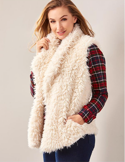 Charlie Paige Soft Faux Fur Vest. Add cozy texture to an outfit with this white faux fur vest designed with an open-front, a shawl collar and two front pockets. Polyester.