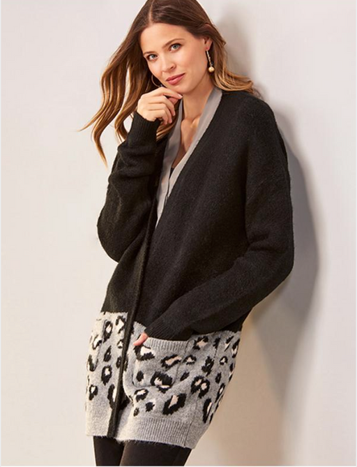 Charlie Paige Animal Pattern Jacquard Cardigan. Bring your look up-to-date with this open-front cardigan designed with a modern leopard print, patch pockets and long sleeves. 2 Assorted Colors: All-Over Print, Half Black and Half Print.