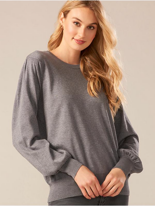 Charle Paige Bishop Sleeve Top. This lightweight knit top designed with long bishop sleeves and a crew neckline is a welcome addition to your wardrobe.