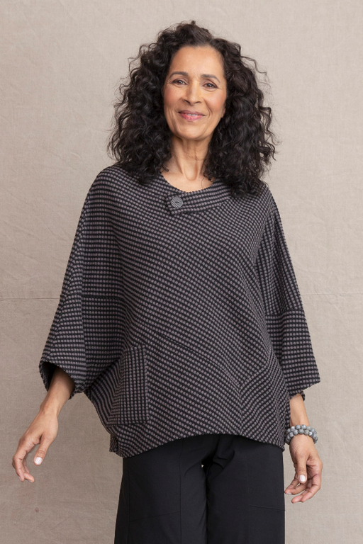 Artful and cozy. Make a statement easily with this throw on showstopper. Super soft dot fleece. Etched grid button at collar. Diagonal seams throughout. Fit/Body: Generous cozy fit. Works on all body types.