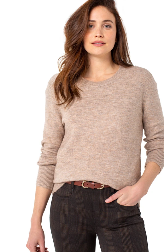 Liverpool High Low Crew Neck Sweater. Cozy Chic! This fabulous crew neck sweater is the perfect piece for the season. Perfect for layering or on its own, this style is versatile and can be styled effortlessly.