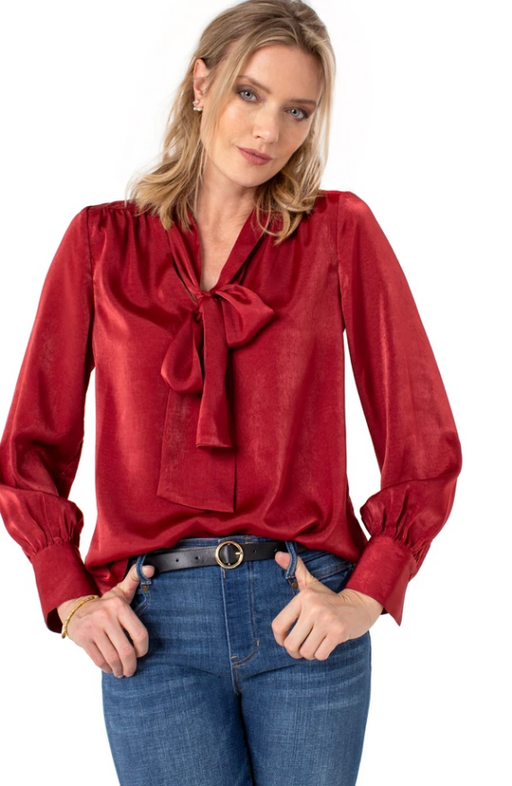 Our Liverpool autumn red blouse with tie detail is just right for the season! This uplifting and vibrant tone is perfect for the woman with style and confidence.