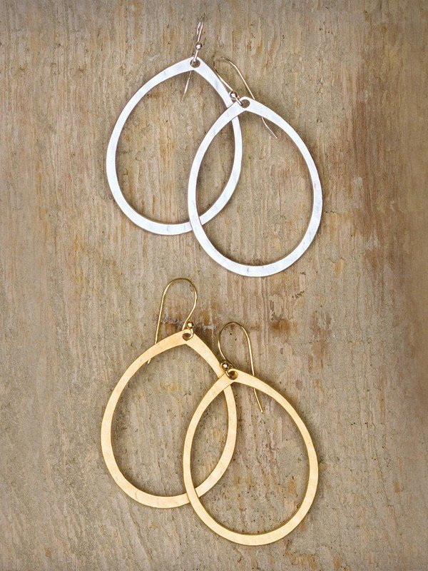 Holly Yashi Halo Earrings. Hand-hammered with modern texture and shine, the stylized hoop of our Halo Earrings offer an elegantly simple way to add versatility to your wardrobe.