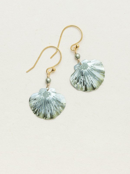 Holly Yashi Sage Shelby Earrings. An iconic remembrance of the sea, our darling Shelby Earrings features a chic clamshell and dainty Swarovski crystal pearl for a look that comes straight from a day on the coast. This elegant design makes for an easy wear-with-anything accent.