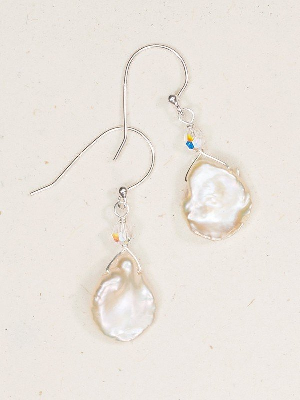 A luminous complement to your own individual style and beauty, our lustrous, radiant, and intriguingly unique Margo Earrings are the ultimate treasure. Rare, free-form Keshi pearls give way to distinctive shapes, sizes, and inclusions, meaning no two are exactly alike.