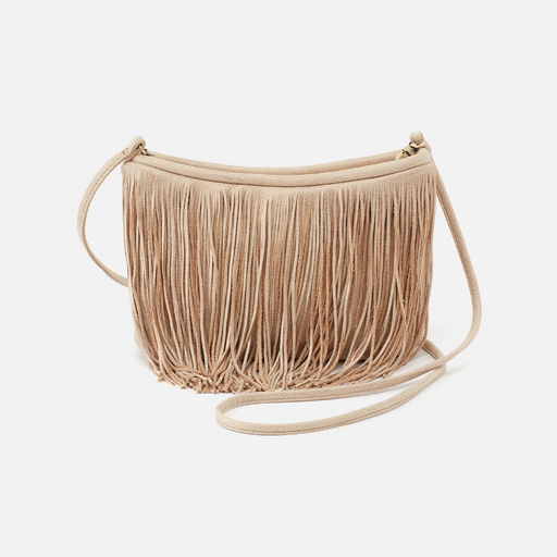 A little sun calls for a lot of fringe! Our Wilder crossbody from the HOBO design archives is back again and the HOBO team could not be more excited. Be hands-free this season with plenty of fringe that moves with you, wherever you go. Crafted in one of our limited-edition metallic hides, this top-grain leather is buffed for a casual feel and finished with a metallic shine creating the perfect balance of grit and grace.