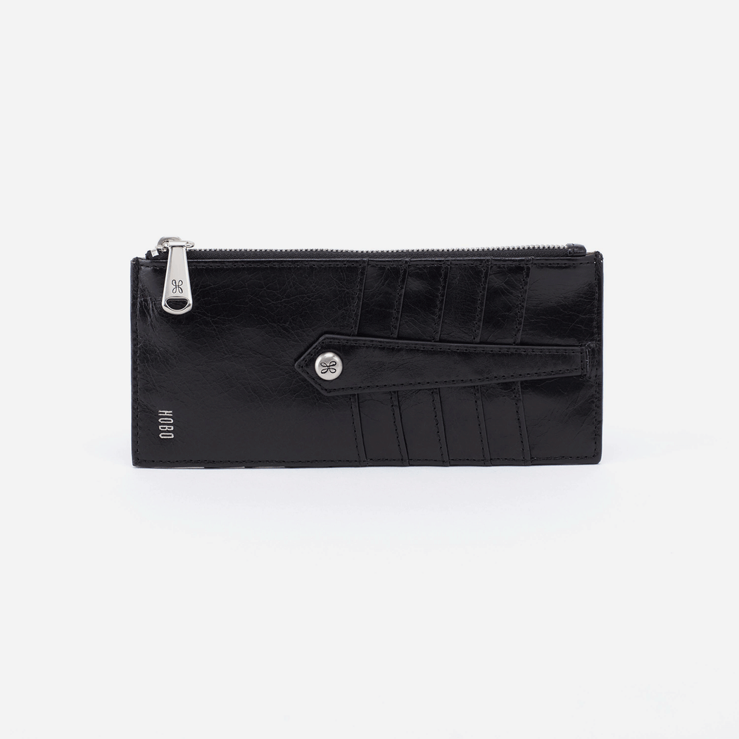 "Designed to hold your frequently used credit cards, ID, and cash, the Linn is a compact and minimal leather credit card case for women.  DETAILS Exterior: 8 Credit Card Slots, ID holder and Zip compartment Wanderlust lining 4"" W x 5.5"" H x 0.25"" D"