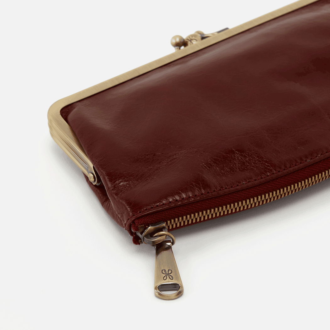 Meet Mavis' little sister - Millie! Our Millie wallet is a smaller version of the vintage inspired clutch. Millie is the perfect balance of glam & practicality, with a hidden bottom zipper & interior pockets for your cards & cash in a classic kiss-lock frame. Crafted in our signature vintage hide leather that only gets more beautiful over time with use and wear.