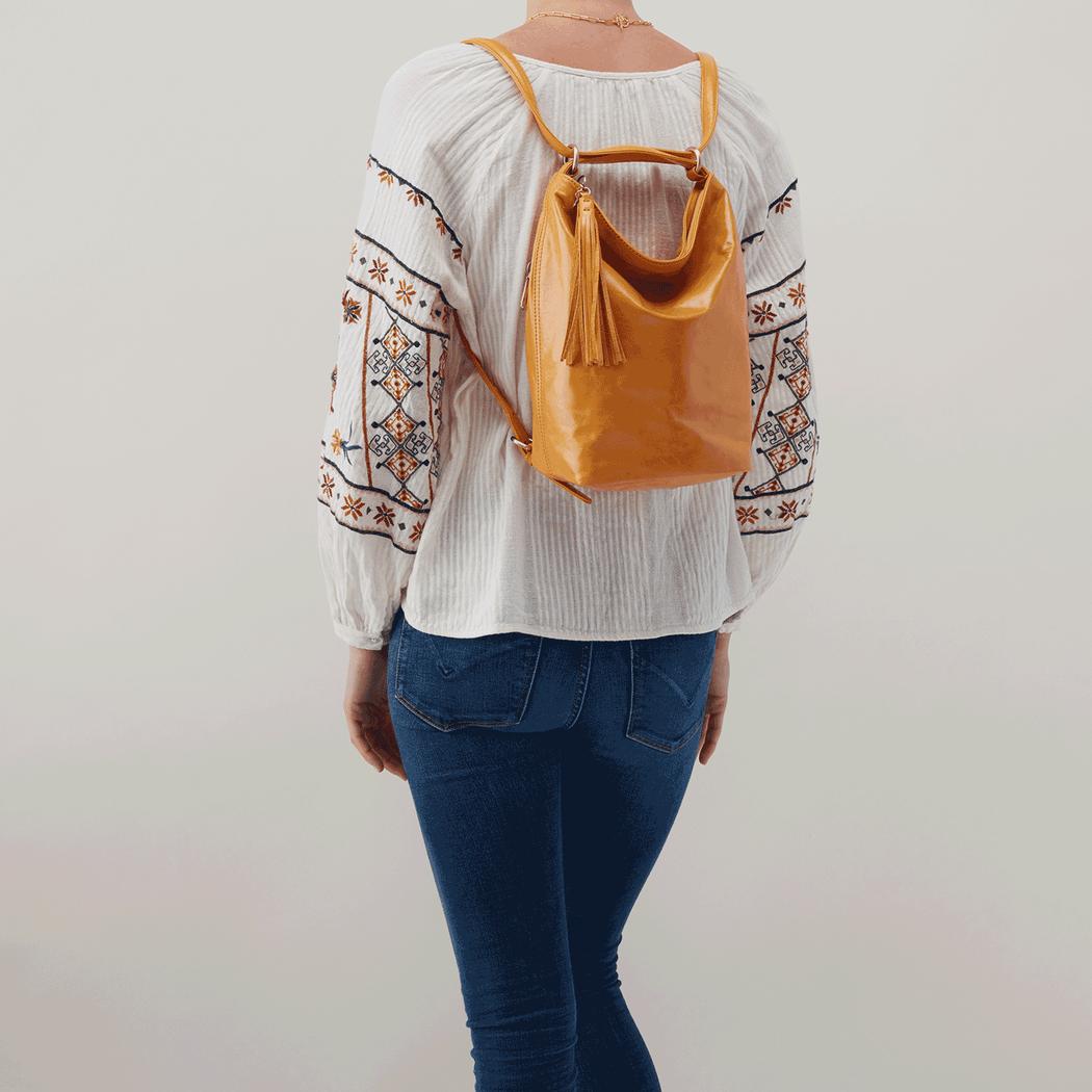 Three bags in one. Our best-selling convertible bag, Blaze, pulls triple duty with a simple pull of the straps. Carry it as a chic bucket bag, slouchy one-shoulder sling, or a cool backpack. Crafted in our signature vintage hide leather that only gets more beautiful over time with use and wear.