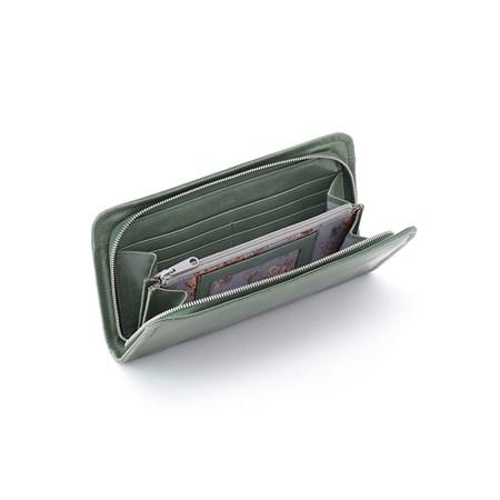 "A simple zip-around wallet crafted in vintage hide that only gets more beautiful over time with daily wear. Inside you will find slots and compartments for your cash, cards, ID, and coins.  DETAILS Brushed Nickel hardware Zip closure Interior: Center zip compartment, 2 bill slots, ID holder, Slip pocket, 8 Credit Card slots Wanderlust lining 8.5"" W x 4.5"" H x 1"" D"