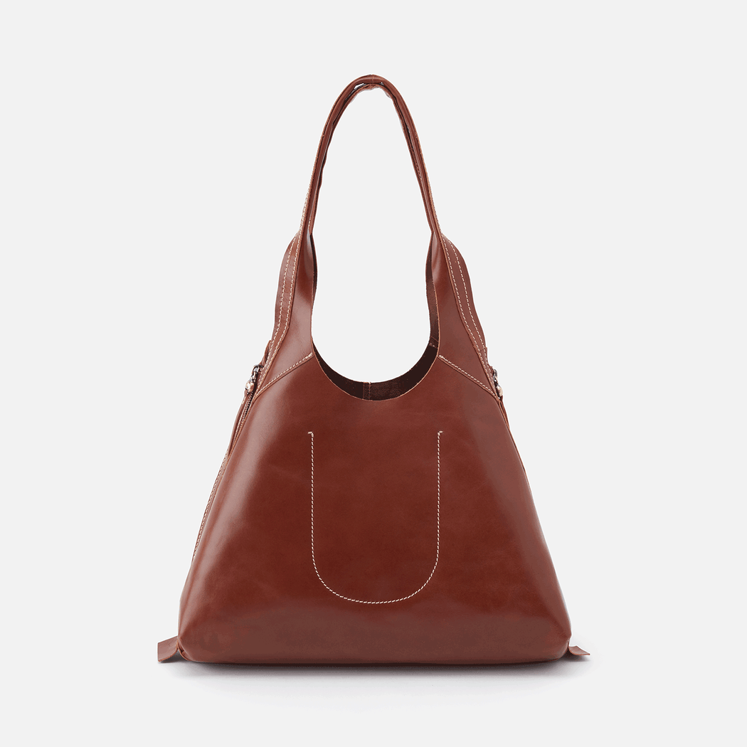 Meet the new Believer shoulder bag; a perfectly-sized tote for stashing your daily take-alongs, like a book, your wallet, sunglasses, and tablet. Crafted in our new Glazed Artisan Hide. Lightweight and unlined, this hide honors the long heritage of fine leathers and the handcraft of generations.