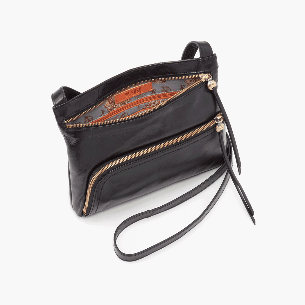 A best-seller, the Cassie crossbody is made for style & utility with exterior pockets that are both cool and functional. Crafted in our signature vintage hide leather that only gets more beautiful over time with use and wear.