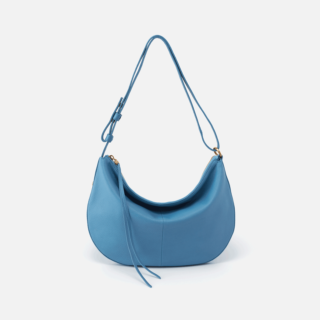 Meet Cosmo. A beautiful half-moon shaped bag with a convertible strap, allowing you to wear it as a shoulder bag or crossbody. Crafted in our signature velvet hide, our softest and most casual leather that only gets more beautiful over time.