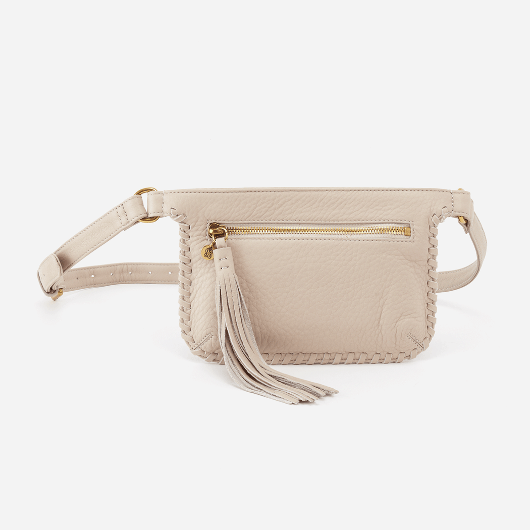 "Old English Brass hardware Zip closure Exterior: Back wall slip pocket Interior: Front wall 2 credit card slots Fits up to an iPhone 8 Plus 8"" W x 5.75"" H x 0.5"" D"