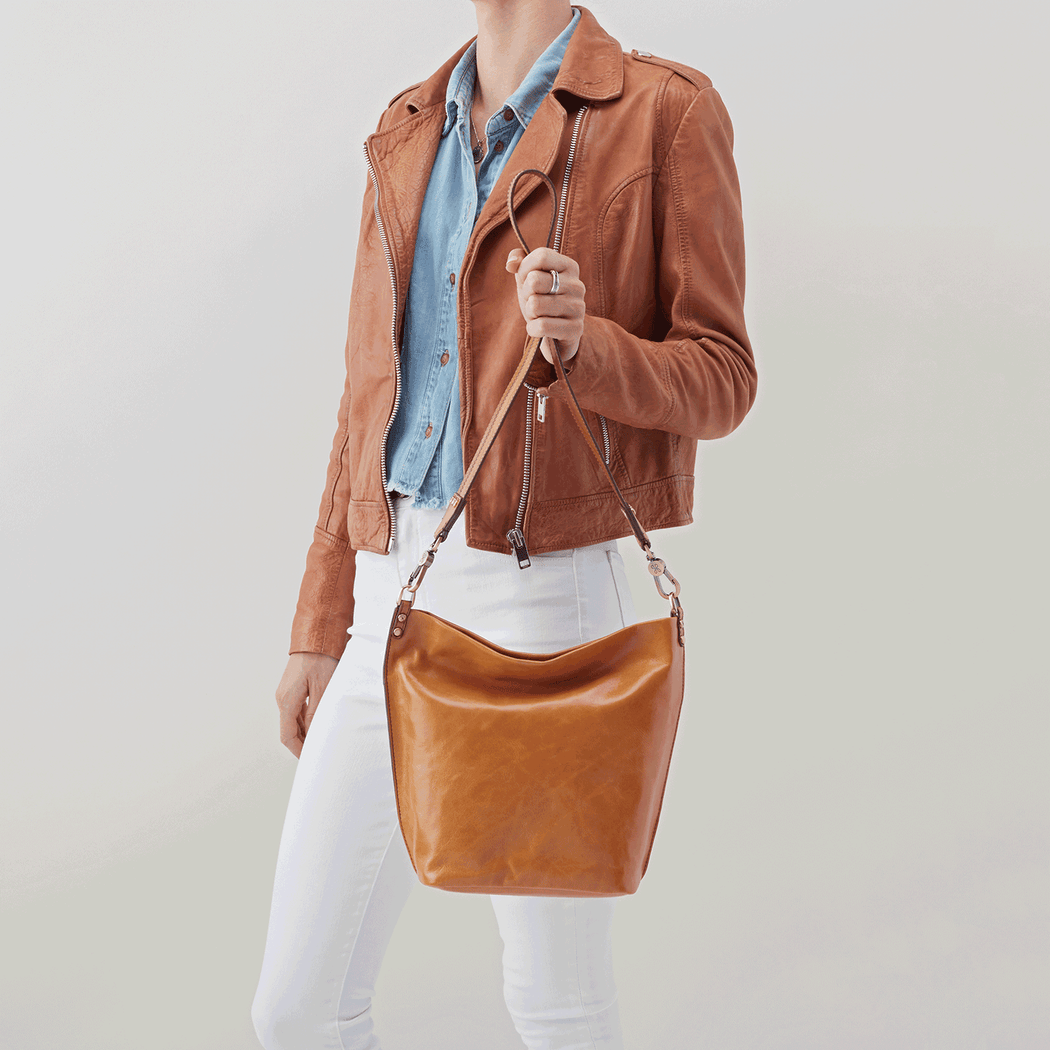 Inspired by a vintage leather bag that our designers fell in love with, the Flare shoulder bag features a wide strap, simple silhouette, and beautiful brass hardware details. Crafted in our signature vintage hide leather that only gets more beautiful over time with use and wear.