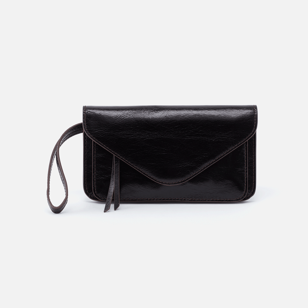 Say hello to a new style: Ford. This wallet turned wristlet is designed with an iconic envelope shape and organized interior layout. Crafted in our signature vintage hide leather that only gets more beautiful over time with use and wear.