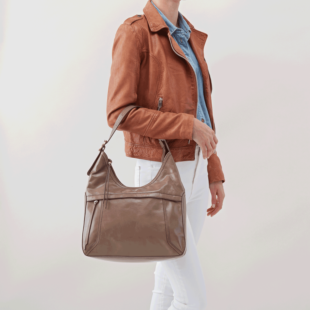 Meet Fortune, an updated version of our most-loved Marley bag from the Hobo archives. Designed to be loved every day, the leather will only get better with use & wear. Crafted in our signature vintage hide leather that only gets more beautiful over time with use and wear.