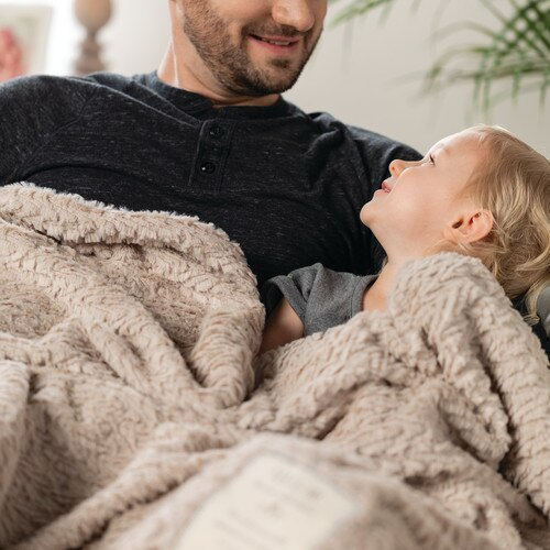 When you want to make those bonding moments with a loved one even more special, consider adding this blanket to your quiet times together. Make sharing time with a child or a partner a wonderful memory. The full-size You and Me Cuddle Blanket in taupe is a perfect piece for cuddling on the couch or sharing a bedtime story with your little one.