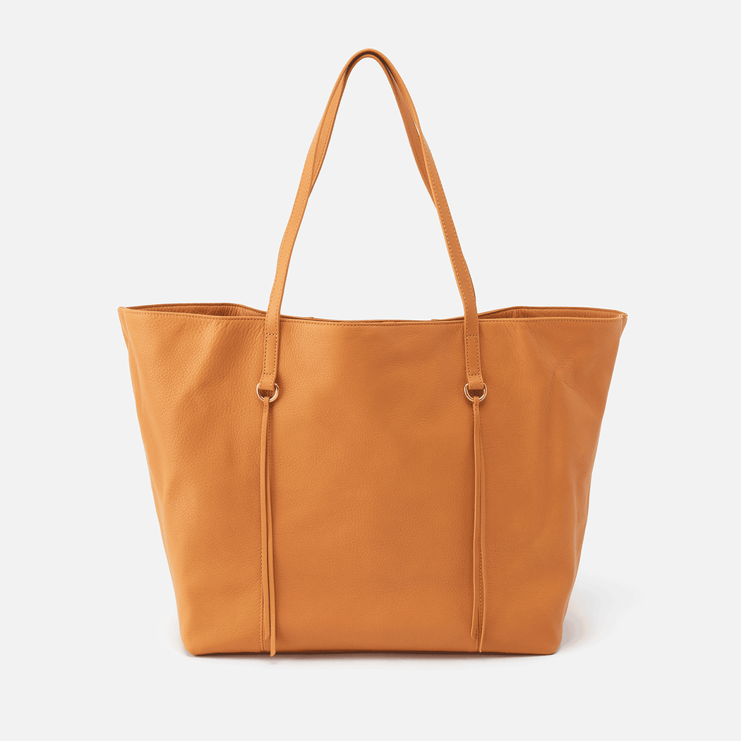 A Hobo icon, the Kingston leather tote is the perfect travel carry-on bag, work tote, and mom bag because of its spacious interior.  Crafted in our signature velvet hide, our softest and most casual leather that only gets more beautiful over time.