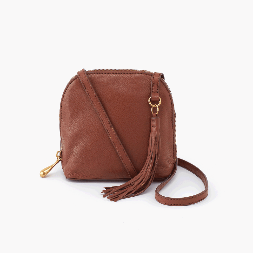 "A best seller & Hobo icon, the Nash crossbody purse is a boho-chic leather bag that you'll reach for on downsized days. Crafted in our signature velvet hide, our softest and most casual leather that only gets more beautiful over time.  Old English Brass hardware Top zip closure Exterior: Back wall slip pocket Interior: Back wall zip pocket; center zip compartment; front wall slip and pen pockets Fits your cell phone Wanderlust lining Solid leather single strap 23 - 26"" Strap Drop 6.25"" W x 6.5"" H x 3"" D"