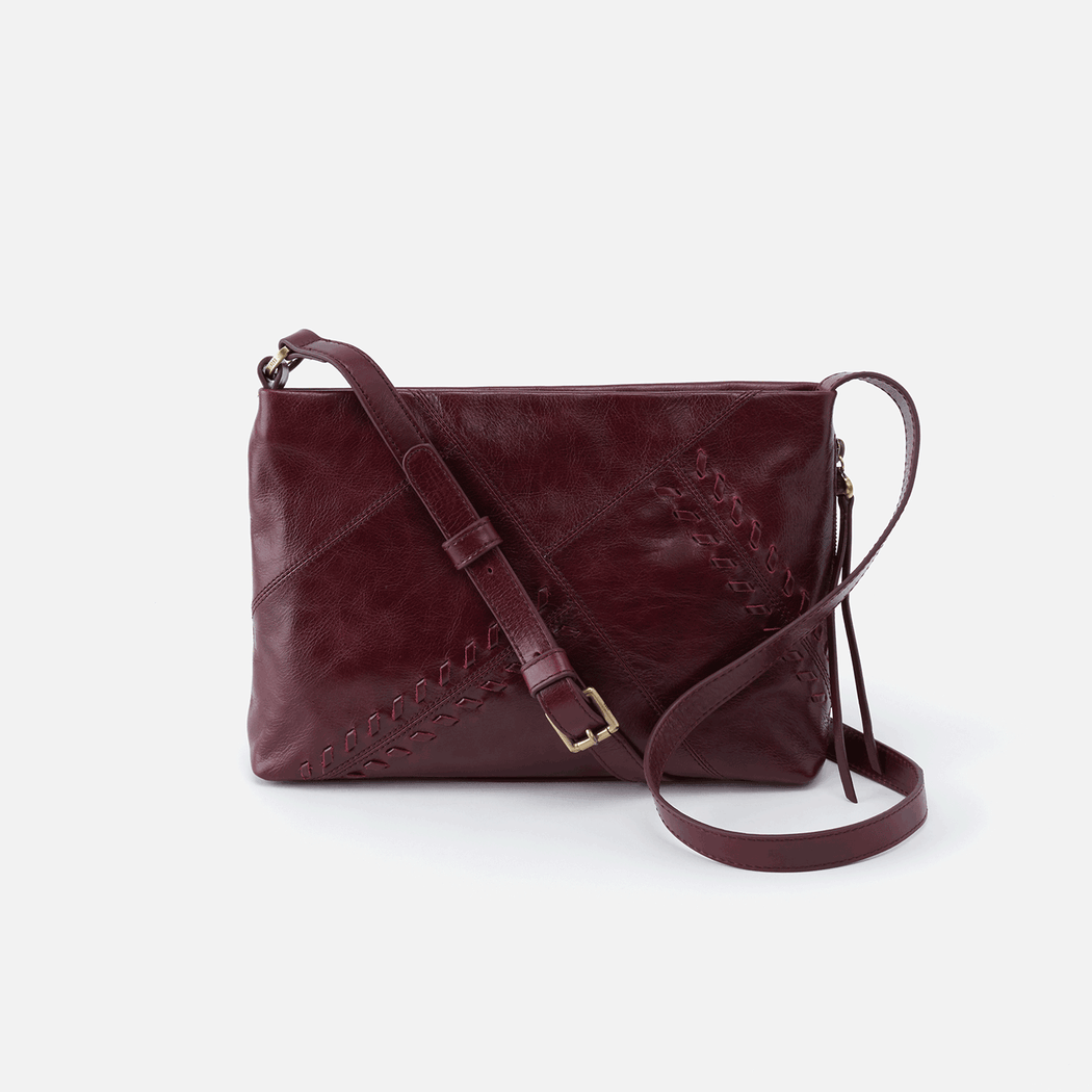 Meet Prairie, your new everyday crossbody. Designed intentionally with whipstitch details, our signature smartphone pocket, and an adjustable strap. Crafted in our signature vintage hide leather that only gets more beautiful over time with use and wear.  Brushed Antique Brass hardware Top Zip Closure Back wall cell phone pocket, side wall zipper pocket Back wall zip pocket, slip pocket and pen pocket; front wall double slip pocket  Fits your cell phone and reader Wanderlust Lining Solid leather single strap