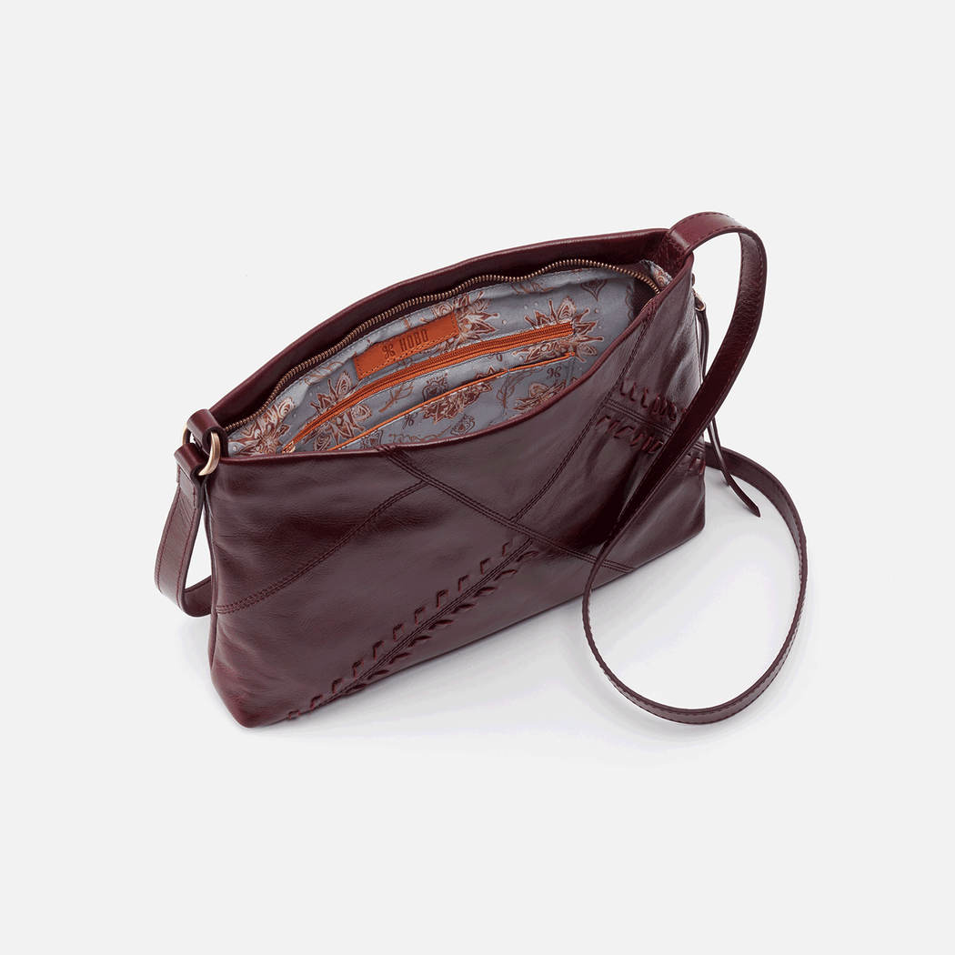 Meet Prairie, your new everyday crossbody. Designed intentionally with whipstitch details, our signature smartphone pocket, and an adjustable strap. Crafted in our signature vintage hide leather that only gets more beautiful over time with use and wear.