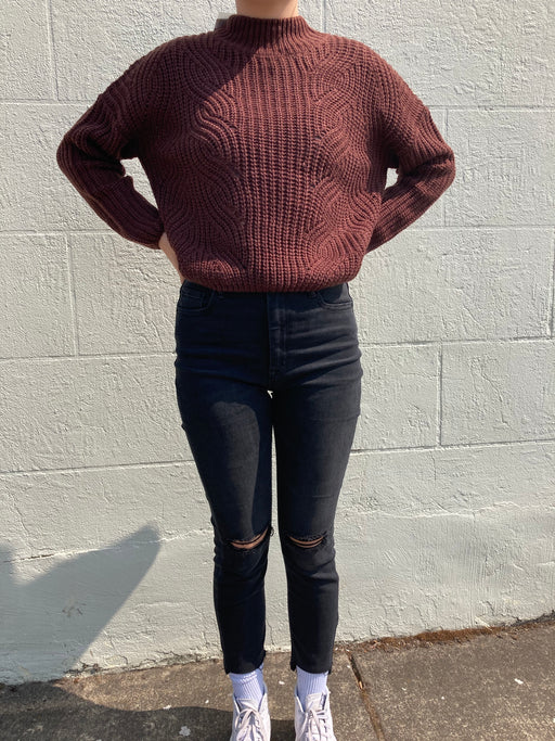 The Yona Sweater is made from a chunky sweater knit and features a bright multicolor stripe pattern. This cropped, relaxed crewneck sweater has a drop shoulder design and oversized sleeves for a cozy feel that is reminiscent of being wrapped up in a fluffy blanket. Pair with denim for a fall look that stands out.
