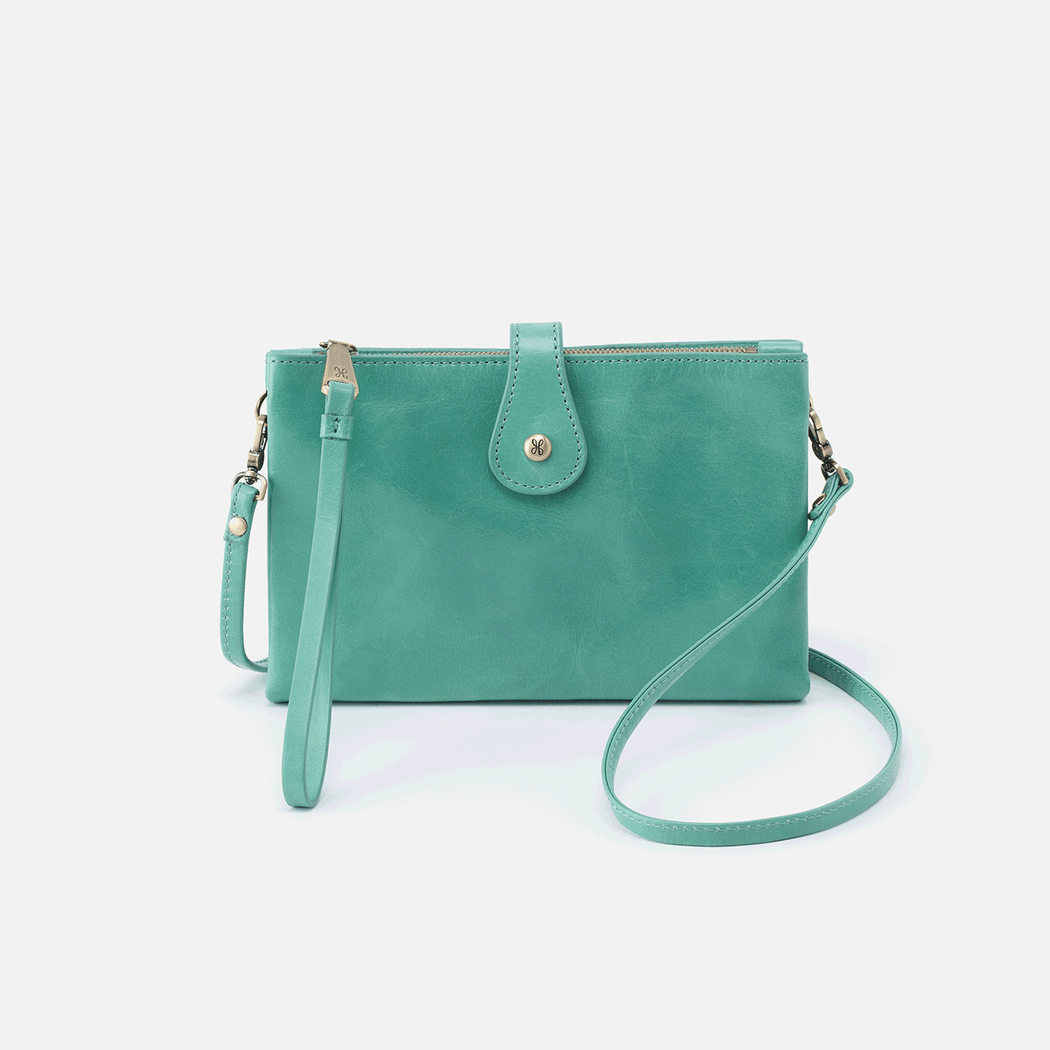 The Reveal crossbody features a zip closure design with two strap options for convertibility. Switch from a crossbody to a wristlet, depending on your mood. Crafted in our signature vintage hide leather that only gets more beautiful over time with use and wear.