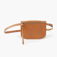 Say hello to Saunter, a leather belt bag featuring endless adjustability and just enough interior space for your phone, cards, and keys. Take a style note from the fashion bloggers and wear it as a short crossbody purse, too. Crafted in our signature vintage hide leather that only gets more beautiful over time with use and wear.  Brushed Antique Brass Hardware Hidden Magnet Exterior: Front zip pocket Interior: Slip pocket, ID holder and 3 slot credit card wall Fits most cell phones Wanderlust Lining Solid l