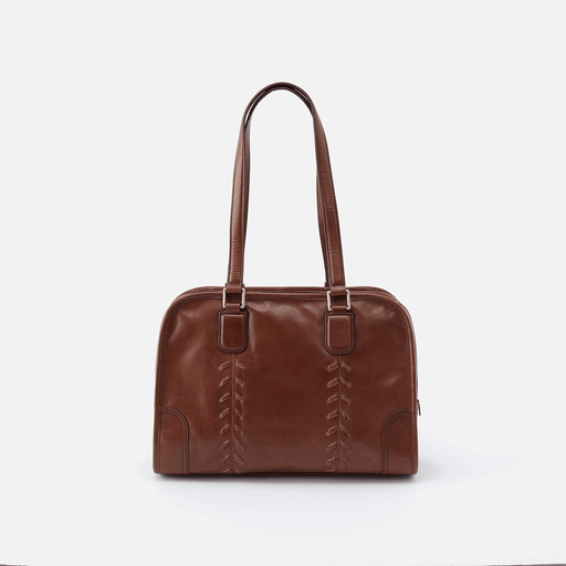 Meet Sutton. A top handle shoulder bag with a structured bag appearance and whipstitch details for a handcrafted feel. Crafted in our signature vintage hide leather that only gets more beautiful over time with use and wear.