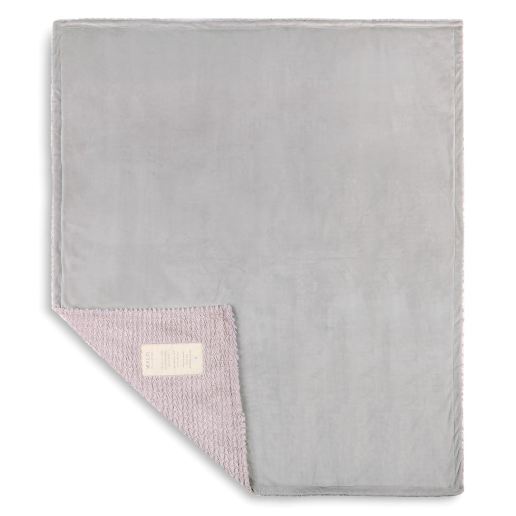 The Mom and Me Cuddle Blanket is a great gift for mom and those awaiting a baby. The blanket's plush design in dusty lavender, with a personalized patch for Mom, invites a great way to snuggle up and bond with baby. It will turn a special moment into a sweet memory for Mom.