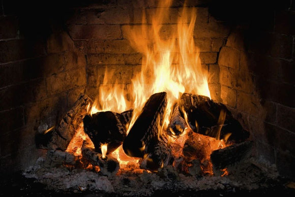 Government moves to ban certain fuels used in wood burners and open fires in bid to improve air quality