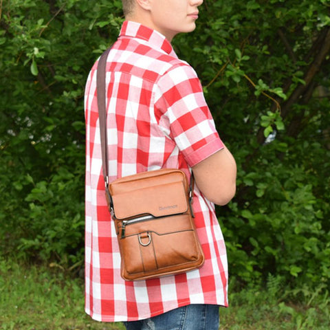man carrying Leather Messenger Bag
