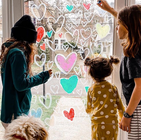 girls window painting with kwik stix