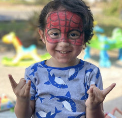 boy with spider man face paint