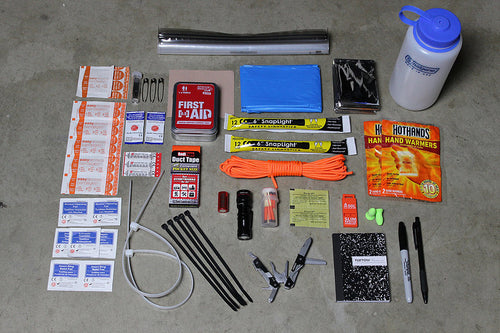SURVIVAL CONTENTS LAID OUT. NEBO MICRO REDLINE GERBER VISE MULTI TOOL 32 OZ NALGENE 4 KATADYN MICROPUR TABLETS 15 UCO STORMPROOF MATCHES ADVENTURE MEDICAL KITS FIRST AID KIT 2.0 2 CYALUME CHEM LIGHTS S.O.L RESCUE HOWLER WHISTLE EMERGENCY PONCHO EMERGENCY BLANKET 25 FT 550 PARACORD  5 YD REDITAPE DUCT TAPE 2 HOT HANDS HAND WARMERS LARGE ZIP TIES 5 SMALL ZIP TIES 2 AA DURACELL BATTERIES SHARPIE AND BALLPOINT BEN NOTEPAD EARPLUGS
