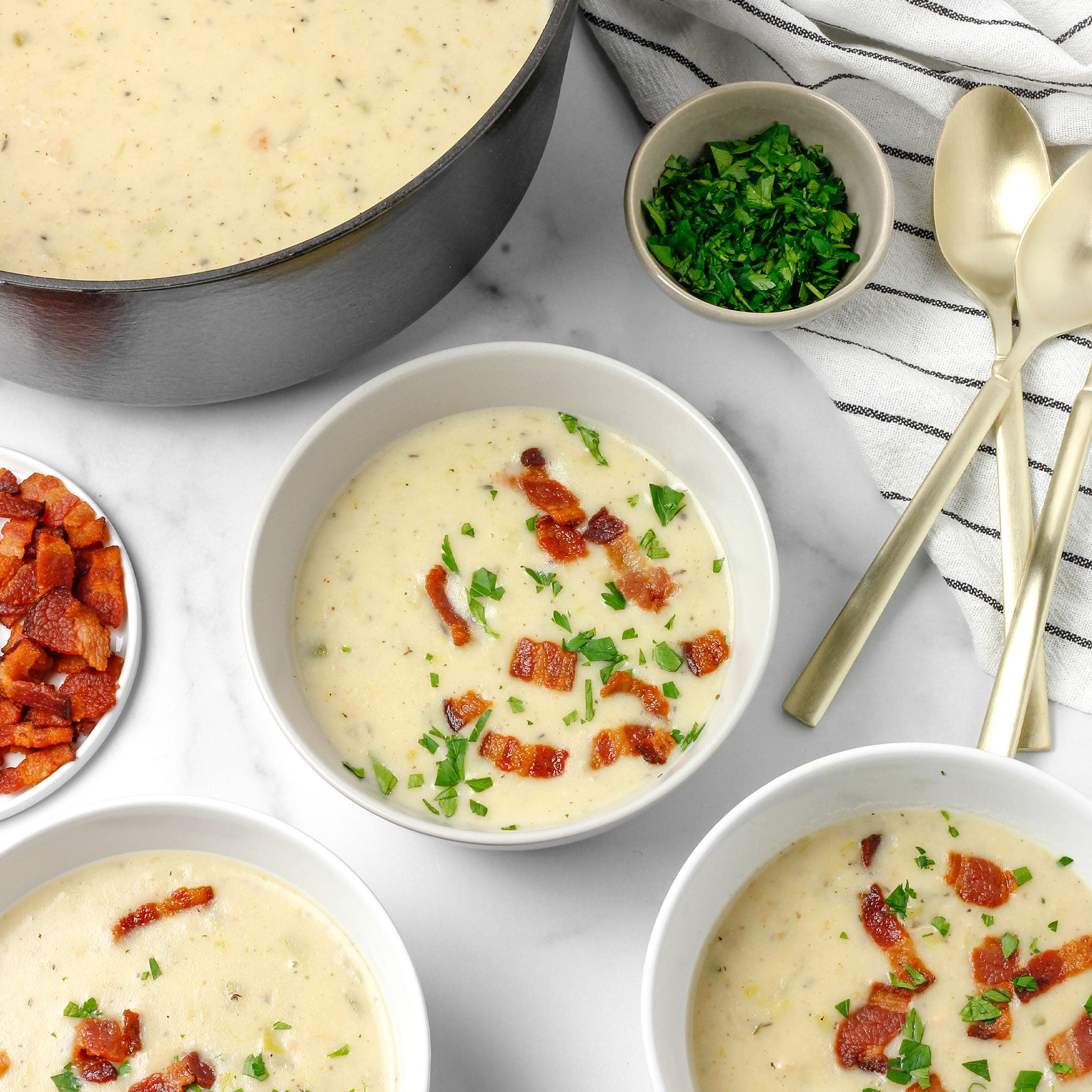 Clam chowder in white bowls