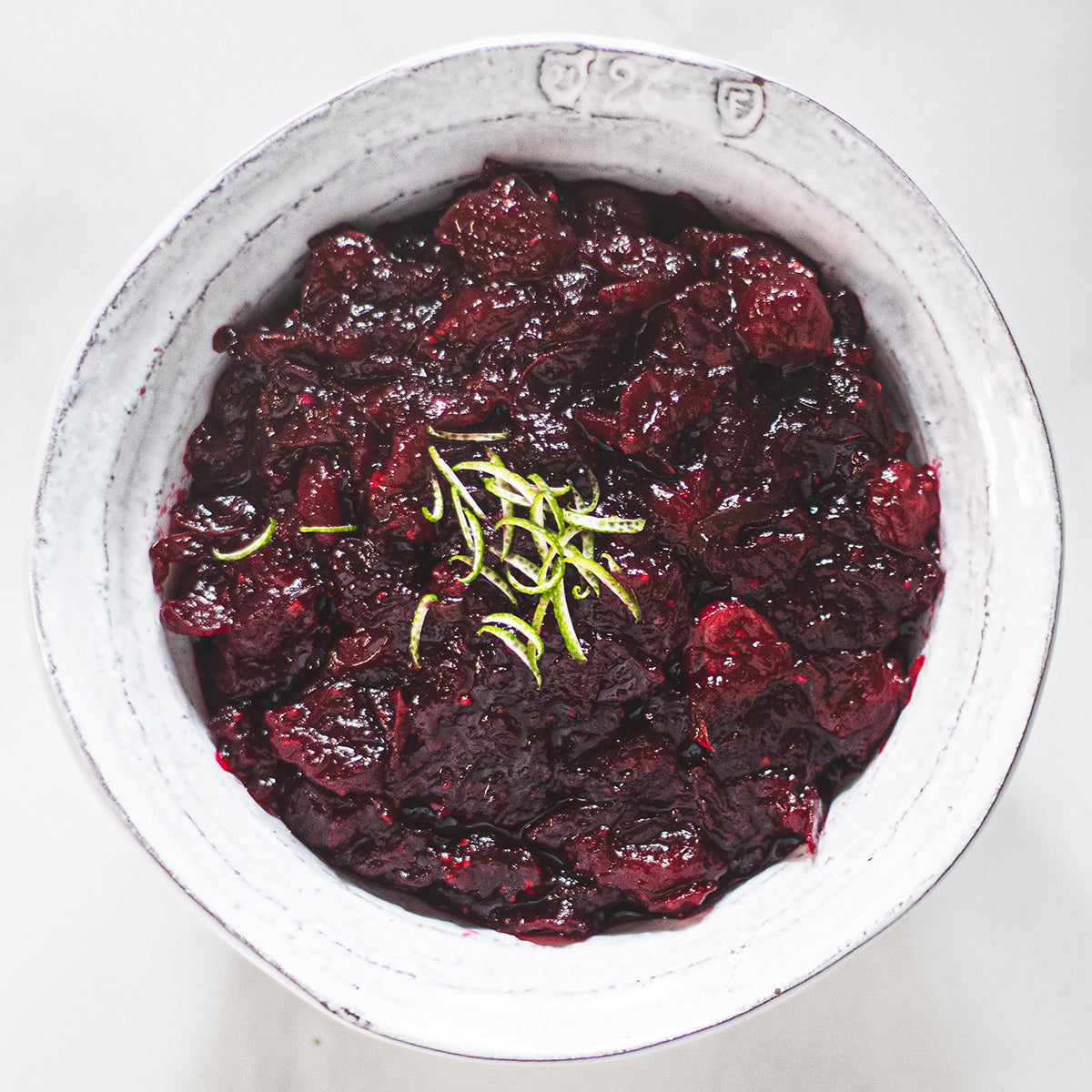holiday cranberry sauce with lime and chili in white bowl
